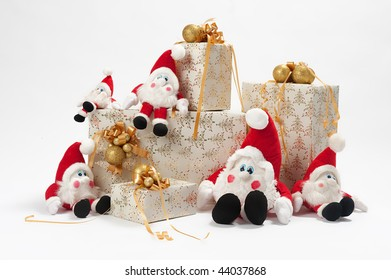Christmas gifts and five gnomes isolated on white background