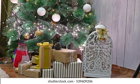 Christmas gifts interior tree and New Year room toys blinking lights and fireplace
