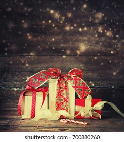 Christmas Gifts on wooden background - Shutterstock ID 700880260