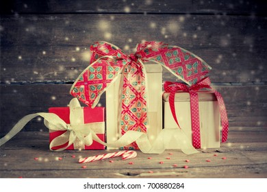 Christmas Gifts on wooden background - Shutterstock ID 700880284