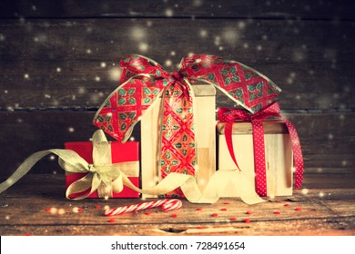 Christmas Gifts on wooden background - Shutterstock ID 728491654