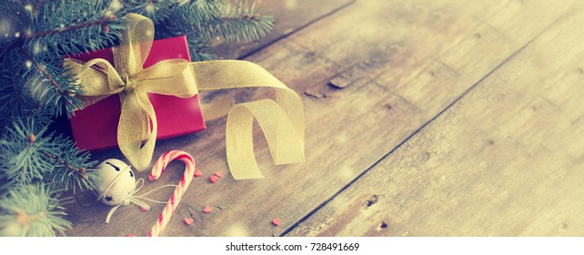 Christmas Gifts on wooden background - Shutterstock ID 728491669