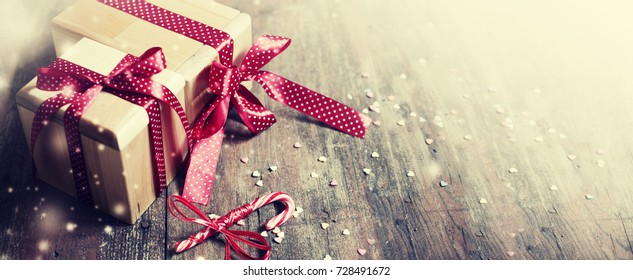 Christmas Gifts on wooden background - Shutterstock ID 728491672