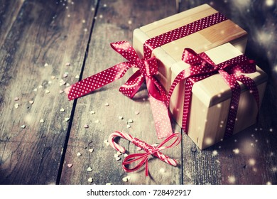 Christmas Gifts on wooden background - Shutterstock ID 728492917