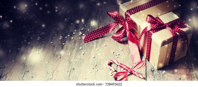 Christmas Gifts on wooden background - Shutterstock ID 728493622