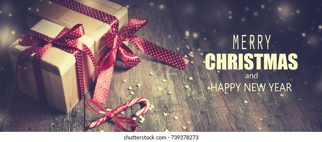 Christmas Gifts on wooden background - Shutterstock ID 739378273