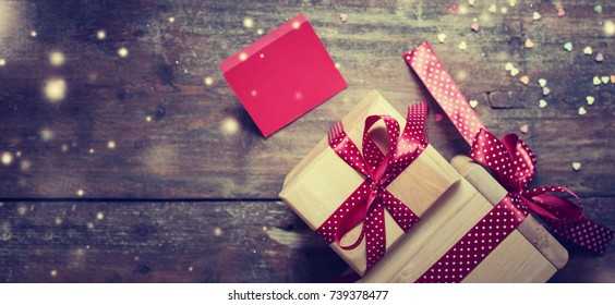 Christmas Gifts on wooden background - Shutterstock ID 739378477