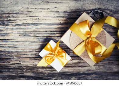 Christmas Gifts on wooden background - Shutterstock ID 745045357