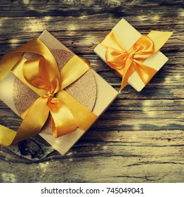 Christmas Gifts on wooden background - Shutterstock ID 745049041