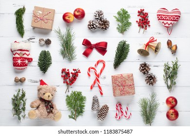 Christmas gifts, pine branches, apples and ribbon on wooden table.Top view,flat lay.