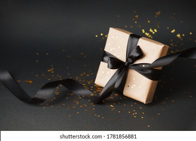 Christmas gifts, presents, ornaments on black holiday background. Merry Christmas, black friday luxury stylish greeting card, frame. Winter xmas holiday theme. Happy New Year, banner - Shutterstock ID 1781856881