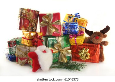Christmas gifts and tree branch against a white background