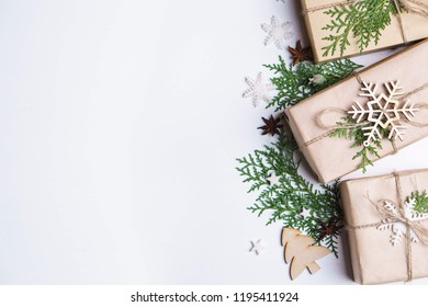 Christmas gifts, tree branches and decorations on white. Winter holiday background for New year cards, banners and party posters