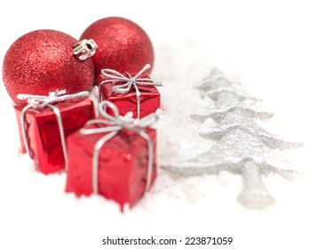 Christmas gifts and the tree on the snow