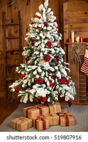 Christmas gifts under the beautiful snowy tree. New Year home interior
