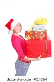 Christmas gifts. Woman wrapping christmas presents wearing santa hat.