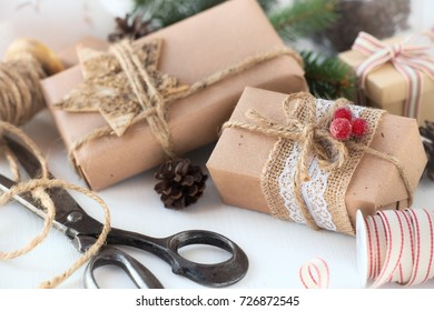Christmas gifts wrapped in brown craft paper with festive decorations