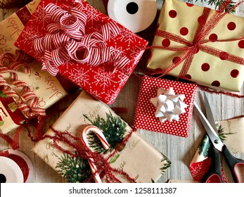 Christmas gifts with wrapping and ribbon on a rustic wooden surface