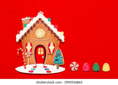 christmas ginger bread house on a red background