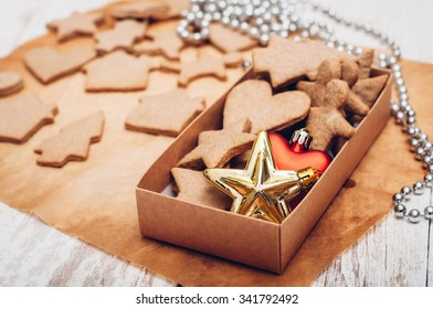 Christmas ginger cookies on white background and baking paper
