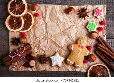 Christmas ginger and honey colorful cookies on a old wooden table