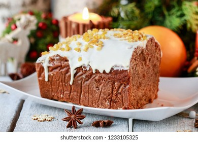 Christmas gingerbread cake among traditional decorations.