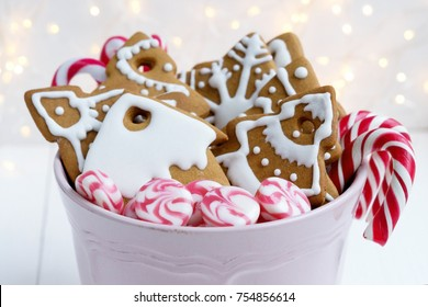 Christmas gingerbread cookies with candy canes. Christmas sweets.