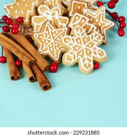Christmas Gingerbread Cookies and Cinnamon Blue Background