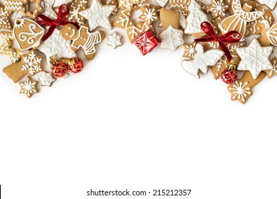 Christmas gingerbread cookies frame on white background. Snowflake, star, man, angel shapes.