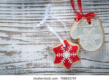 Christmas gingerbread cookies on vintage wooden board holidays concept.
