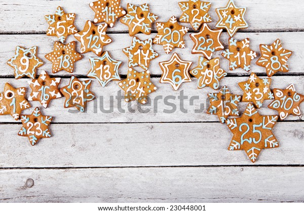 Christmas gingerbread cookies on white table, top view