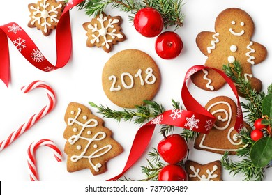 christmas gingerbread cookies and ornaments on white background