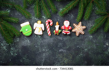 Christmas gingerbread cookies in shape of Santa, snowflake, cand