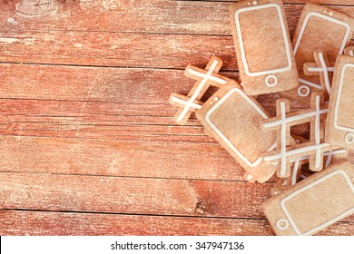 Christmas gingerbread cookies in the shape of smartphone and hashtag symbol.