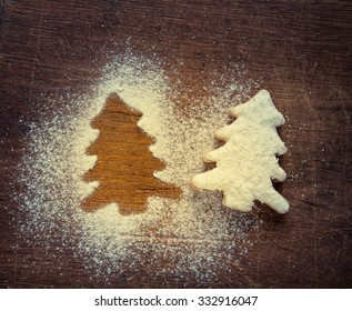 Christmas Gingerbread cookies in the shape of star on the wooden dark background