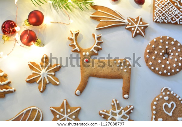 Christmas gingerbread decorated cookies, reindeer shape. Flat lay composition