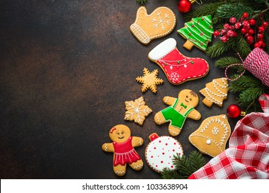 Christmas gingerbread with christmas decorations on dark  backgr