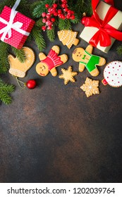 Christmas gingerbread with christmas decorations on dark stone background. Christmas baking background. Top view with copy space.