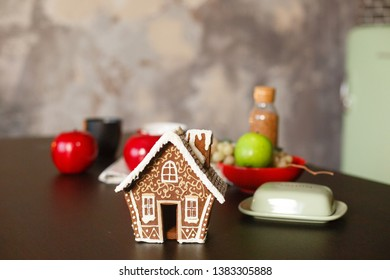 Christmas gingerbread house. Christmas decorated kithen in loft style. Black, green and red colors. Modern loft style of interior decorated for New Year Eve