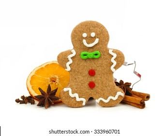 Christmas gingerbread man with cookie cutter and holiday spices isolated on a white background