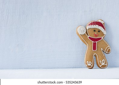 Christmas gingerbread man in front of a blue wall