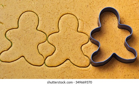 Christmas gingerbread men cookies making with metal cutter