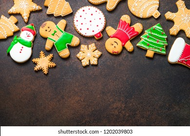 Christmas gingerbread on dark stone background. Christmas baking background. Top view with copy space.