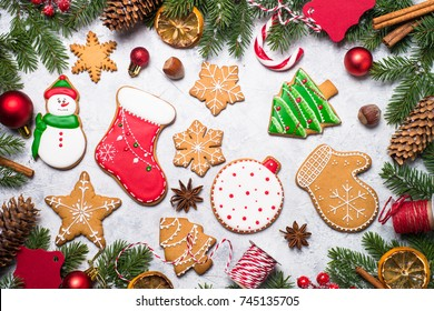Christmas gingerbread with spices and  decorations on gray stone background. Top view with copy space.