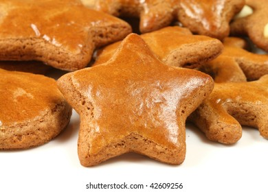 Christmas gingerbread star isolated on white - traditional baked cookies