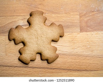 Christmas gingerbread star-shape cookie placed on wooden board