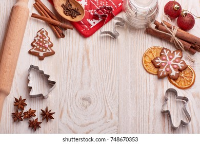 Christmas gingerbreads on a wooden background. New year and Christmas background with copy space for text.  Top view.