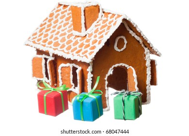 Christmas gingernut house with coloured gift parcels