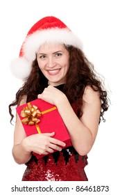 Christmas girl holding gift wearing Santa hat over white background