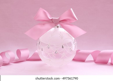 Christmas glass ball with bow on sweet pink
